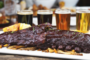 BBQ ribs with french fries and beer sampler